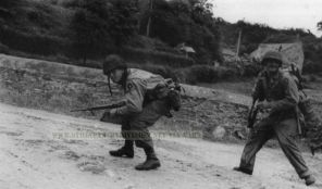 9th Infantry Division men run for cover in Normandy 1944