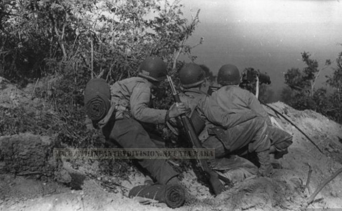 9th Infantry Division men on the lookout during a battle