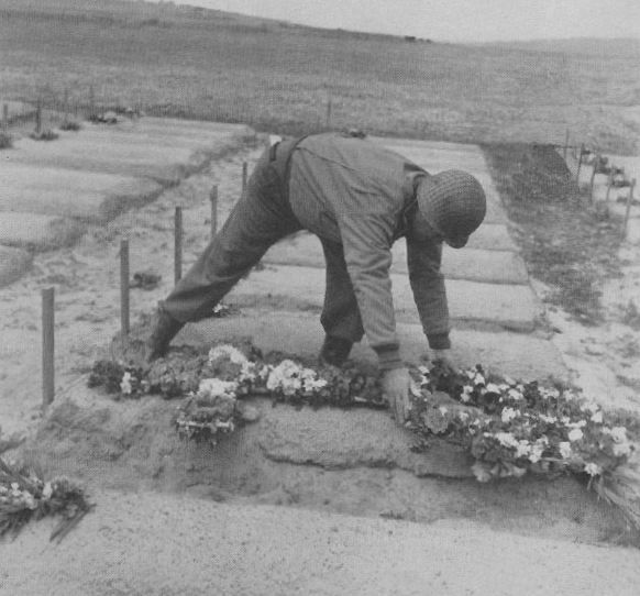 General Eddy placing flowers on a grave