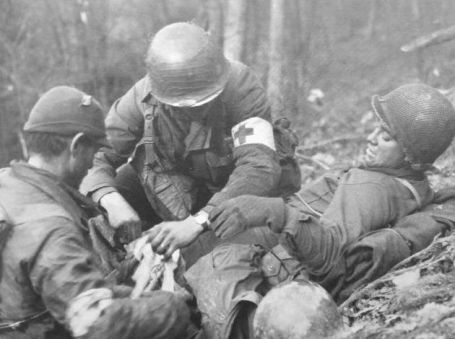 Medics attend to a wounded American Infantry man