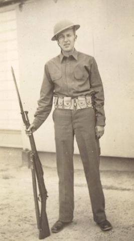 John posing in his uniform at Fort Bragg