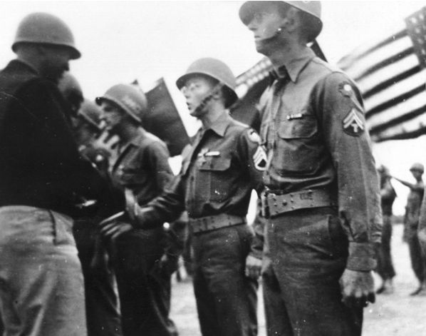 Charles Willsher receiving Distinguished Service Cross from General George S. Patton