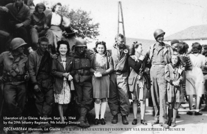Happy locals pose with GIs of the 39th Infantry Regiment in La Gleize, Belgium, September 12th, 1944.