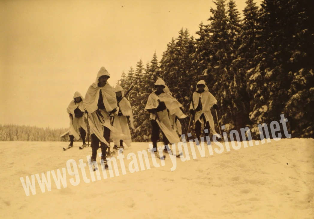 Men of 3rd Battalion, 60th Infantry Regiment on a ski patrol, wearing new snow suits for winter warfare camouflage in January 1945 near Mutzenich, Germany.