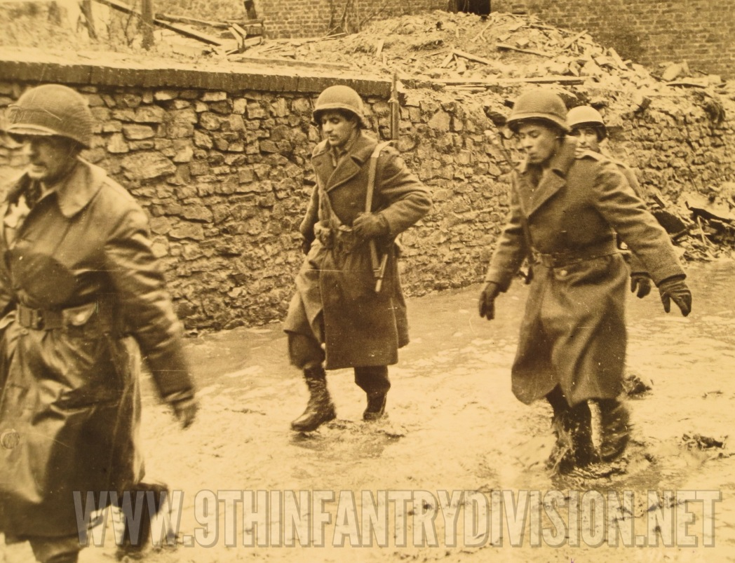 The American soldiers of 2nd Battalion, 39th Infantry Regiment guarding the German prisoners.