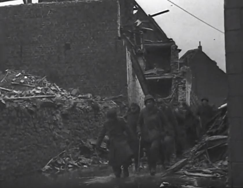 German prisoners walk on the Kapellenstrasse.