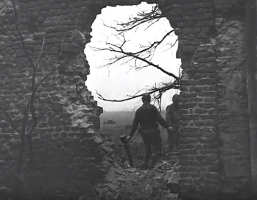A German mortar is clearly visible right behind the wall.