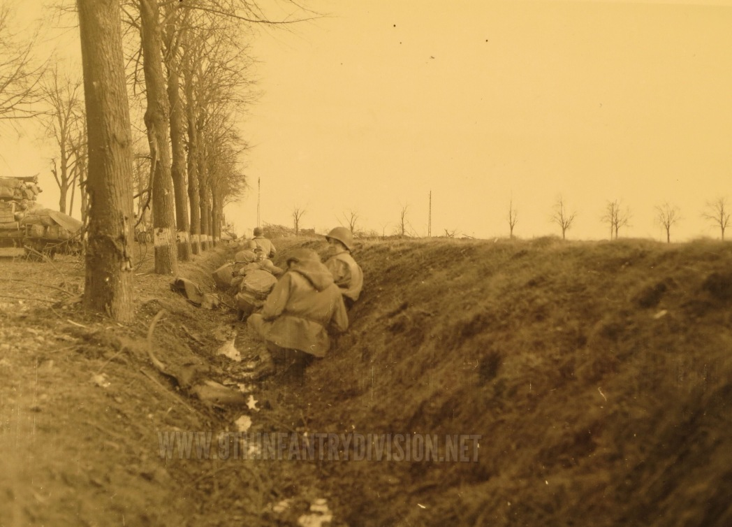 60th Infantry Regiment men take cover in a ditch near Obergeich.