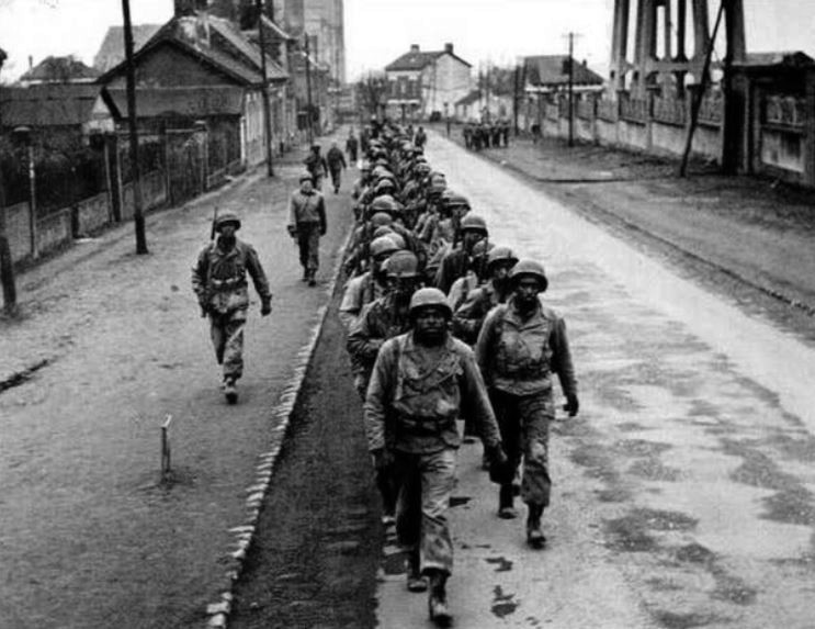 Black soldiers in training in Noyon, France in February 1945